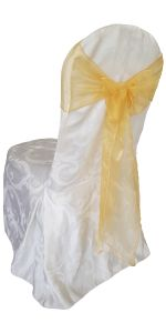 White damask chair cover with gold sash